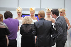 Four models with fanciful hairdo and photographers Stock Photos