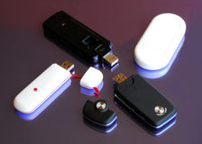Four modem Usb 3G key. USB Modem is a product that connects to the broadband internet. It is connected to the computer via USB which makes the product usable to Stock Images