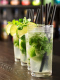 Four Mojito cocktails on a bar counter Royalty Free Stock Photos