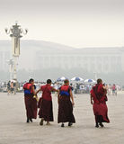 Four monks crossing Tiananmen Square in Beijing Ch Royalty Free Stock Photography