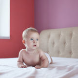 Four-month baby lying in bed Stock Photo