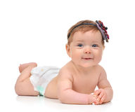 Four month Infant child baby girl in diaper lying happy smiling Royalty Free Stock Photos