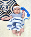 Four month Infant child baby girl lying on a back happy with sun Stock Photo