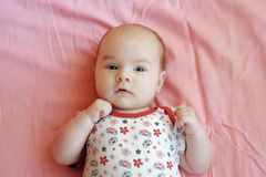 Four month old baby on a pink blanket Royalty Free Stock Photos