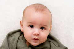 Four month old baby's face Stock Photo