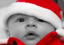 Four month old santa. Four month old baby in red santa outfit for christmas with selective color royalty free stock images