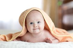 Four months baby girl lying wrapped towel after bathing. Four months baby lying wrapped towel after bathing stock photo