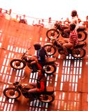 Four motorbike riders on a wall of death in India. Four motorbikes on a wall of death in India Stock Photography