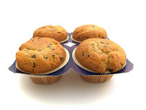 Four muffins. Isolated on the white background Royalty Free Stock Images