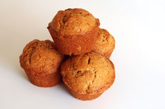 Four muffins. Four banana bread muffins shot against a white background stock photo