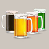 Four mug of different beer. Royalty Free Stock Images