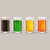 Four mug of different beer. Stock Photo