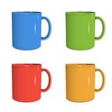 Four mugs of various colors Royalty Free Stock Photography