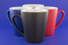 Four multi-colored conical cups Stock Photos