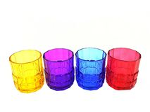 Four multi-colored glasses isolated. On a white background royalty free stock images