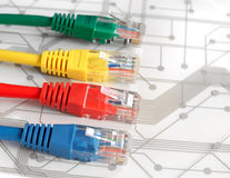 Four Multi Colored Network Cables on Circuit Board Royalty Free Stock Photo