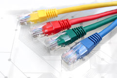 Four Multi Colored Network Cables on Circuit Board Stock Image