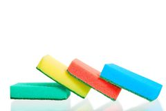 Four multi-colored sponges on white Stock Images
