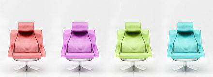 Four multi-coloured armchairs. On the white Royalty Free Stock Images