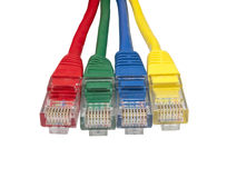 Four multi coloured ethernet network plugs Royalty Free Stock Photography