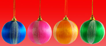 Four multicolored Christmas balls Royalty Free Stock Images