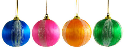 Four multicolored Christmas balls Stock Photo