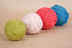 Four multicolored clews Stock Photos