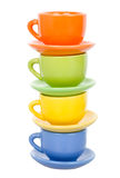 Four multicolored cups, isolated on white Royalty Free Stock Photo