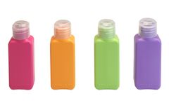 Four Multicolored  Small Plastic  Bottle Isolated On White Stock Image