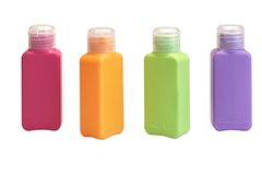 Four Multicolored  Small Plastic  Bottle Isolated On White Royalty Free Stock Images