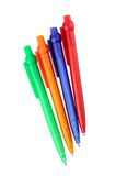 Four multicoloured ball point pens Royalty Free Stock Photos