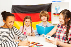 Four multiethnic students studying German at class Royalty Free Stock Photo