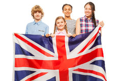 Four multiethnic teenage kids with British flag Stock Image