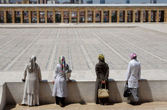Four Muslim Women in Ataturk Mausoleum. Four muslim women with head scarfs and large fashion purses staring the main court of the Ataturk Mausoleum Stock Image
