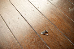 Four nails on a stained timber deck Stock Photography