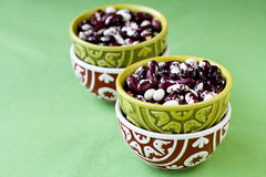 Four national oriental bowls with red and beans Royalty Free Stock Image
