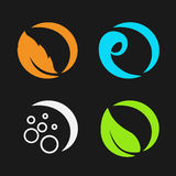 Four natural elements - fire, air, water, earth - nature circular symbols with flame, bubble air, wave water and leaf Stock Photos