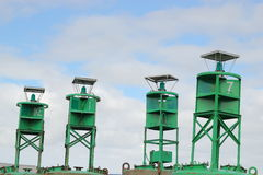 Four navigational buoys Stock Photography
