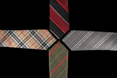 Four neckties with their ends facing each other Stock Photo