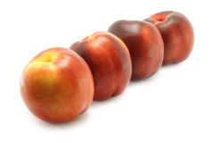 Four nectarines. Close-up on the white background Stock Images