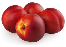 Four nectarines  on white Stock Photography