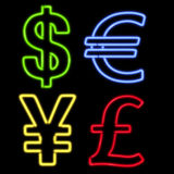 Four Neon Currency Symbols on Black. Colorful neon Dollar, Euro, Yen and Pound Currency symbols isolated on black background Royalty Free Stock Image