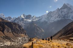 Four nepali men in front of Fish Tail Machapuchare, Himalayas stock photos