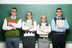 Four nerds in front of blackboard Stock Photography