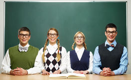 Four nerds in front of blackboard Royalty Free Stock Photo