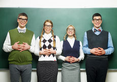 Four nerds in front of blackboard Stock Images