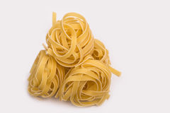 Tagliatelle pasta on a white background Royalty Free Stock Image