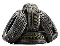 Four new black tires isolated on white Royalty Free Stock Photos