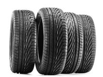 Four new black tires on white Stock Image
