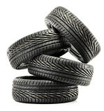 Four new black tires on white Stock Photo